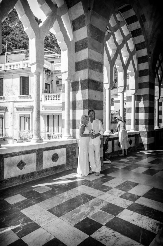 FineArt_Studio_Wedding_In_Amalfi_Paul&Lynne_Street_Duomo_Arch_BW